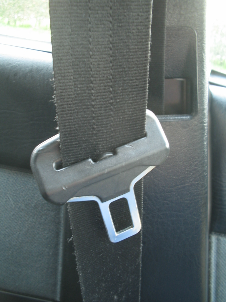 medium resolution of a seat belt and buckle