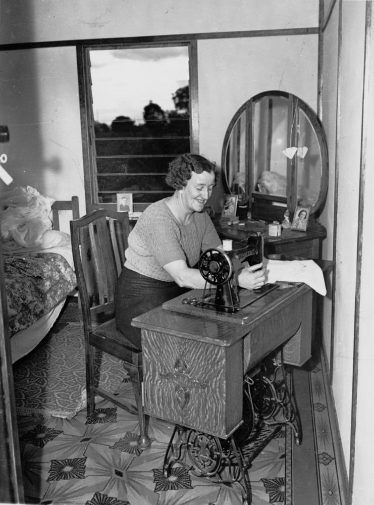FileStateLibQld 1 101812 Woman seated at a Singer treadle