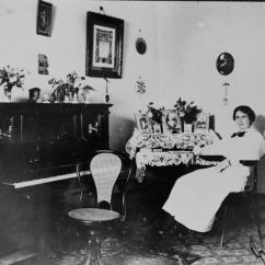 Living Room Desk White Linen Curtains In File:statelibqld 1 50804 Nell Sitting At Her Writing ...