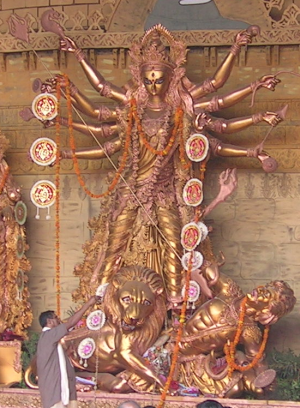 Durga slaying Mahisasur - golden statue. The p...