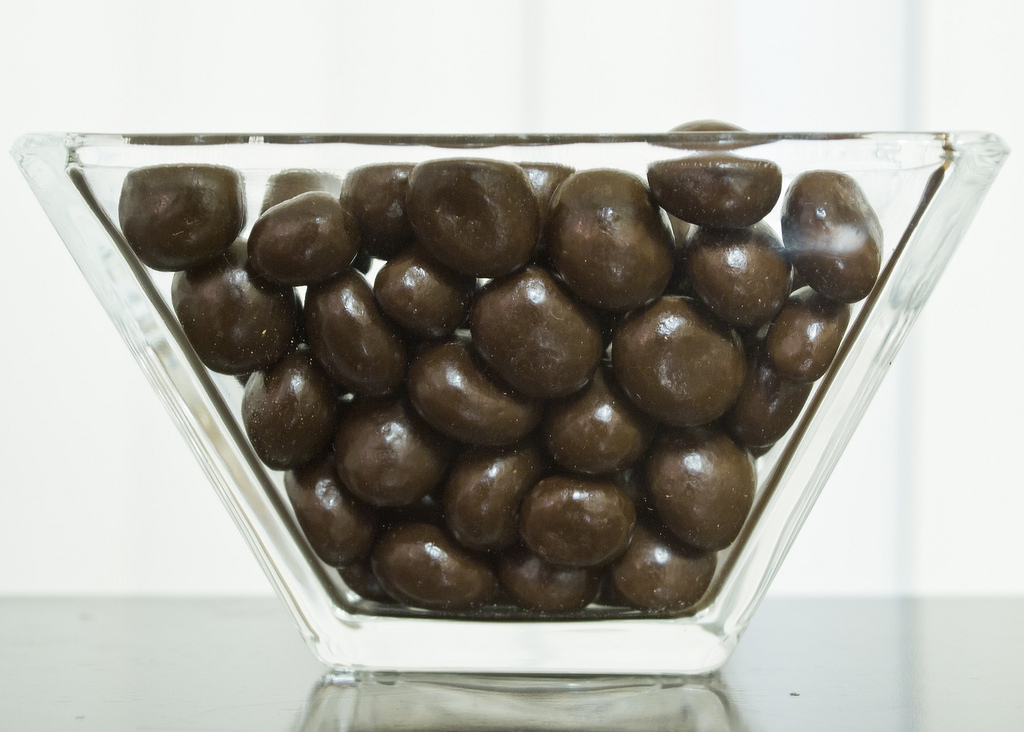 English: A jar of coffee-covered chocolate beans