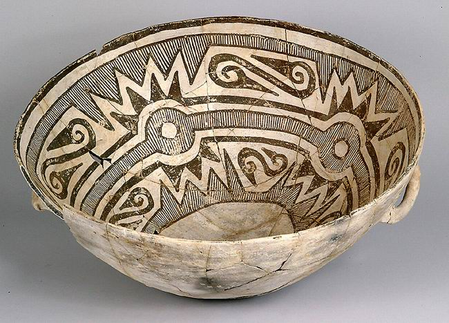 A color picture of a black and white bowl with geometric designs