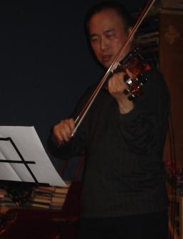 Violinist Jason Kao Hwang performing on 18 Nov...