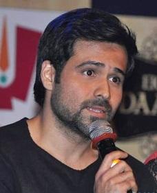 Emraan Hashmi holding a microphone