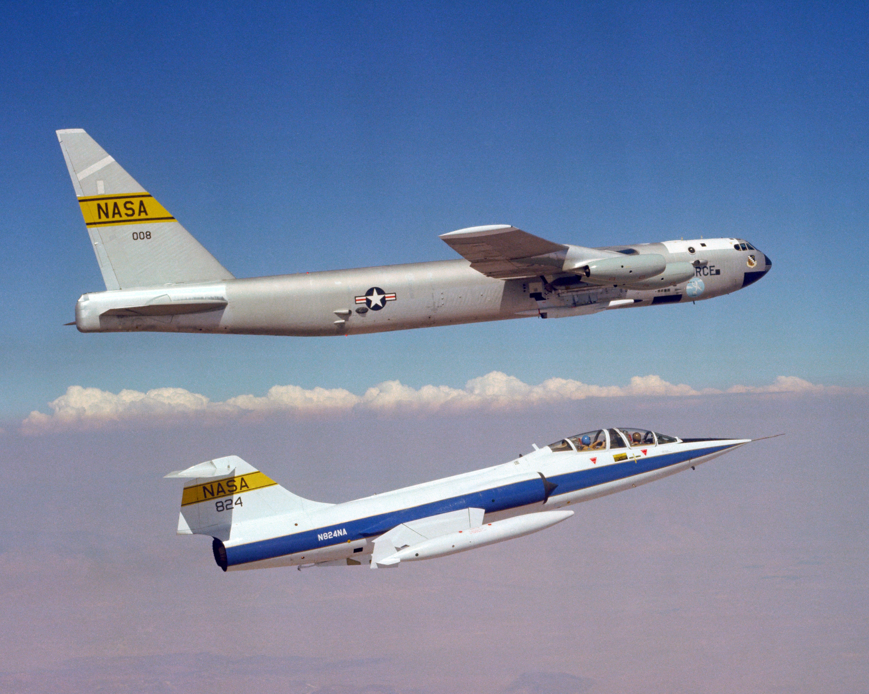 A NASA Lockheed TF-104G Starfighter flies chase on the NASA Boeing NB-52B