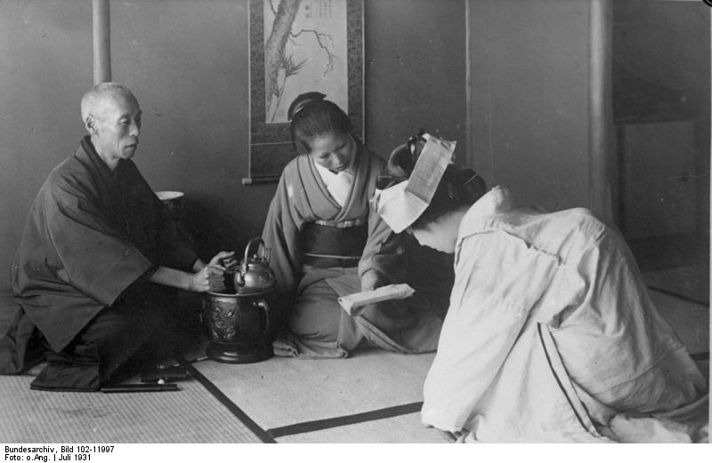 A Japanese woman bows to elders