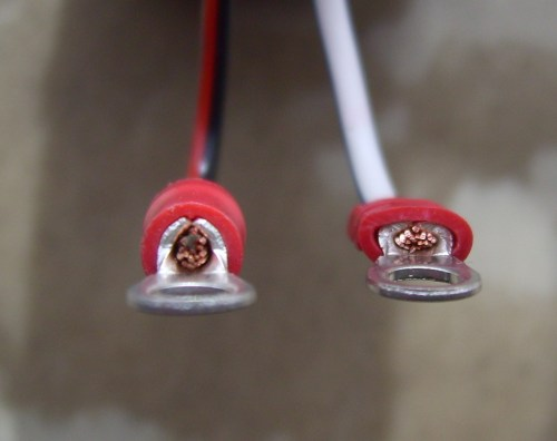 small resolution of close up of two ring tongue terminals