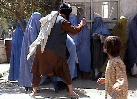 Taliban beating woman in public RAWA