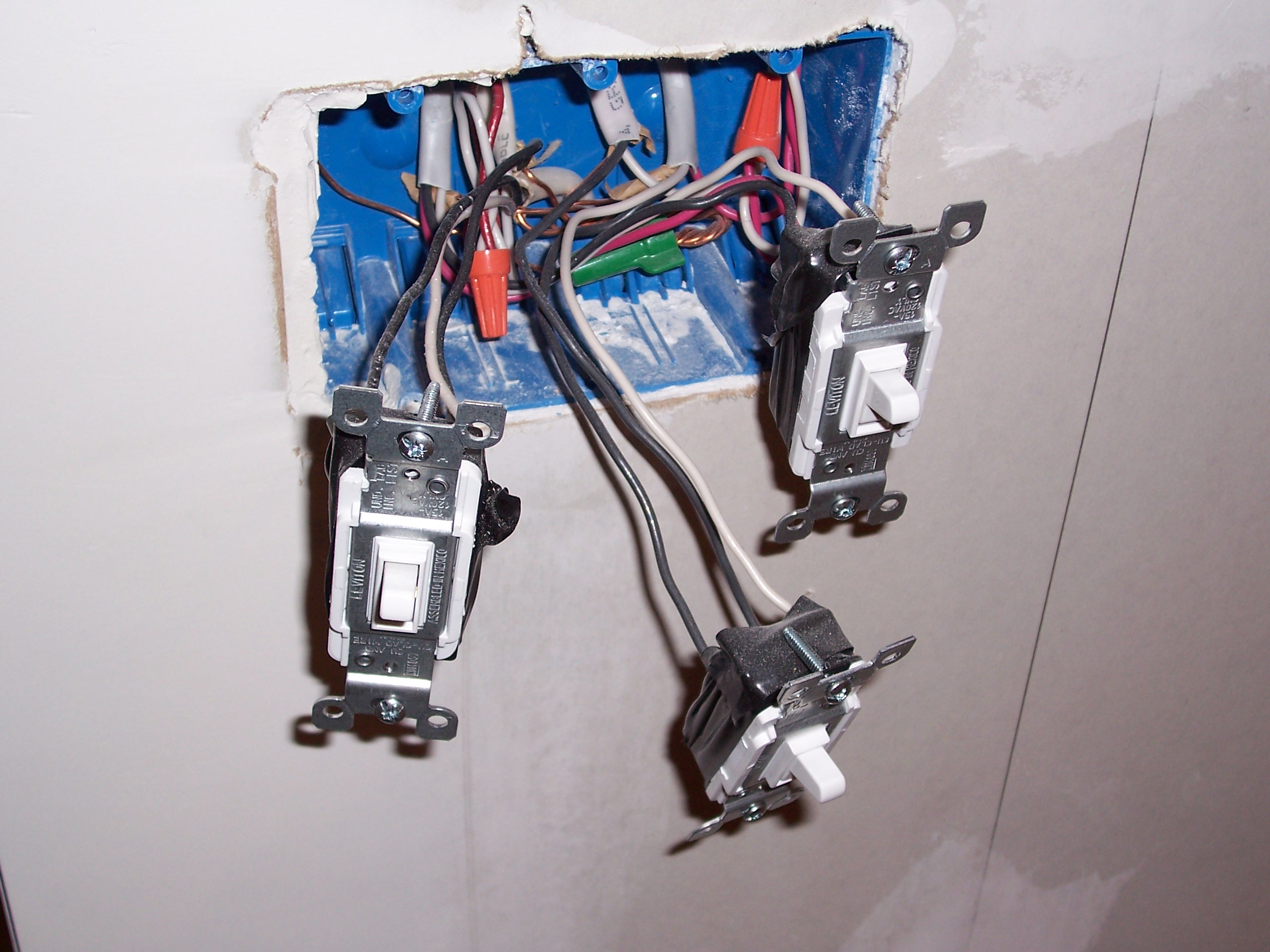 Electrical Switch Boxes Ivoiregion Installing Fan Gfci Into Existing Bathroom Wiringjpg Filethree Light Switches With Exposed Wiring