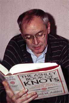 R. D. Laing in 1983, perusing the The Ashley Book of Knots (1944)