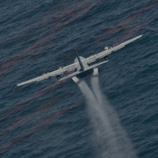 Air force C-130 airplane spraying chemical dis...