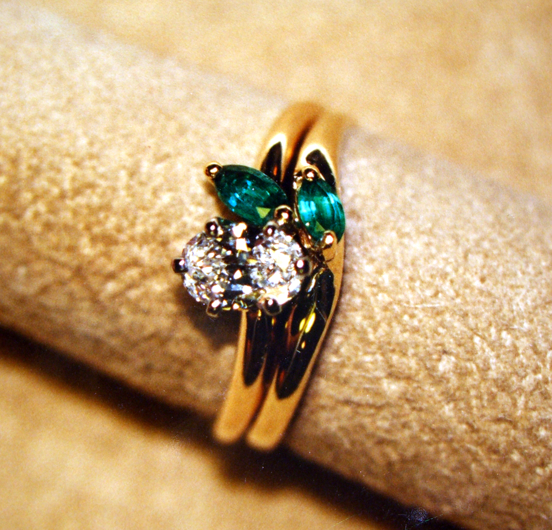 It has one marquise emerald on the 18kt. ring ...