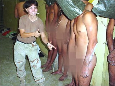 England pointing to a naked prisoner being forced to masturbate in front of his captors.