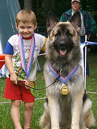 A child with a Shiloh Shepherd Dog. By Tina Barber.