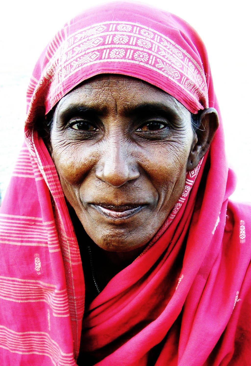 Female beggar at Haji Ali in Mumbai, wearing a...