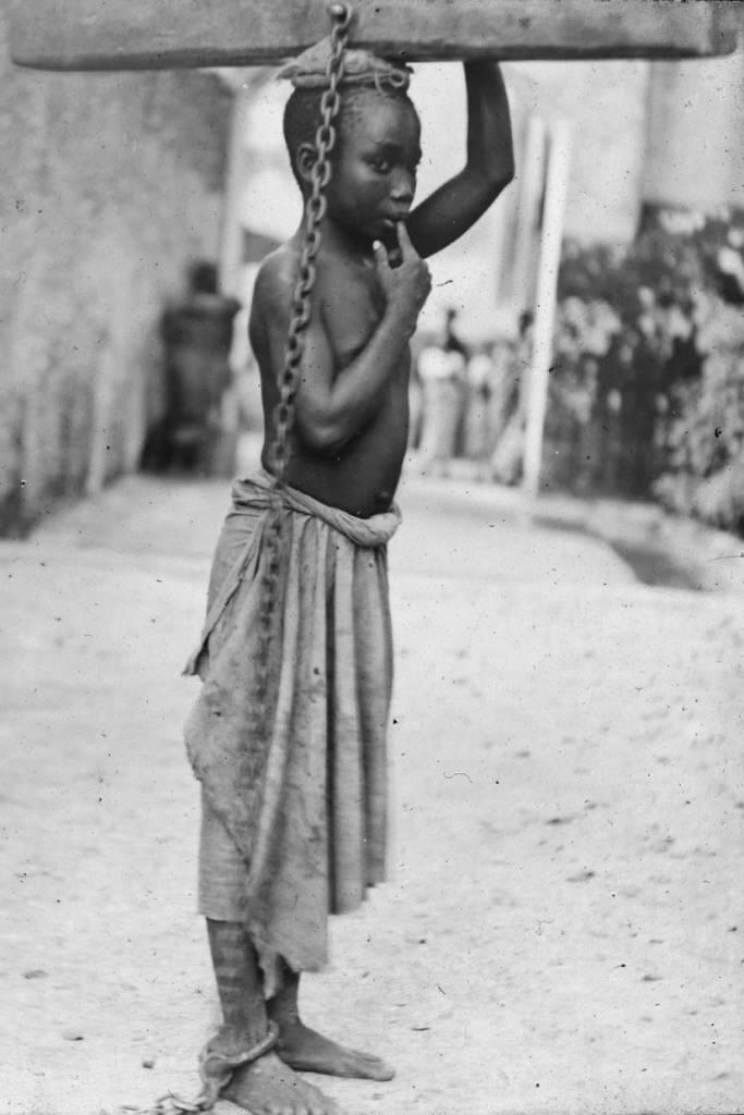 English: Photograph of a slave boy in Zanzibar...