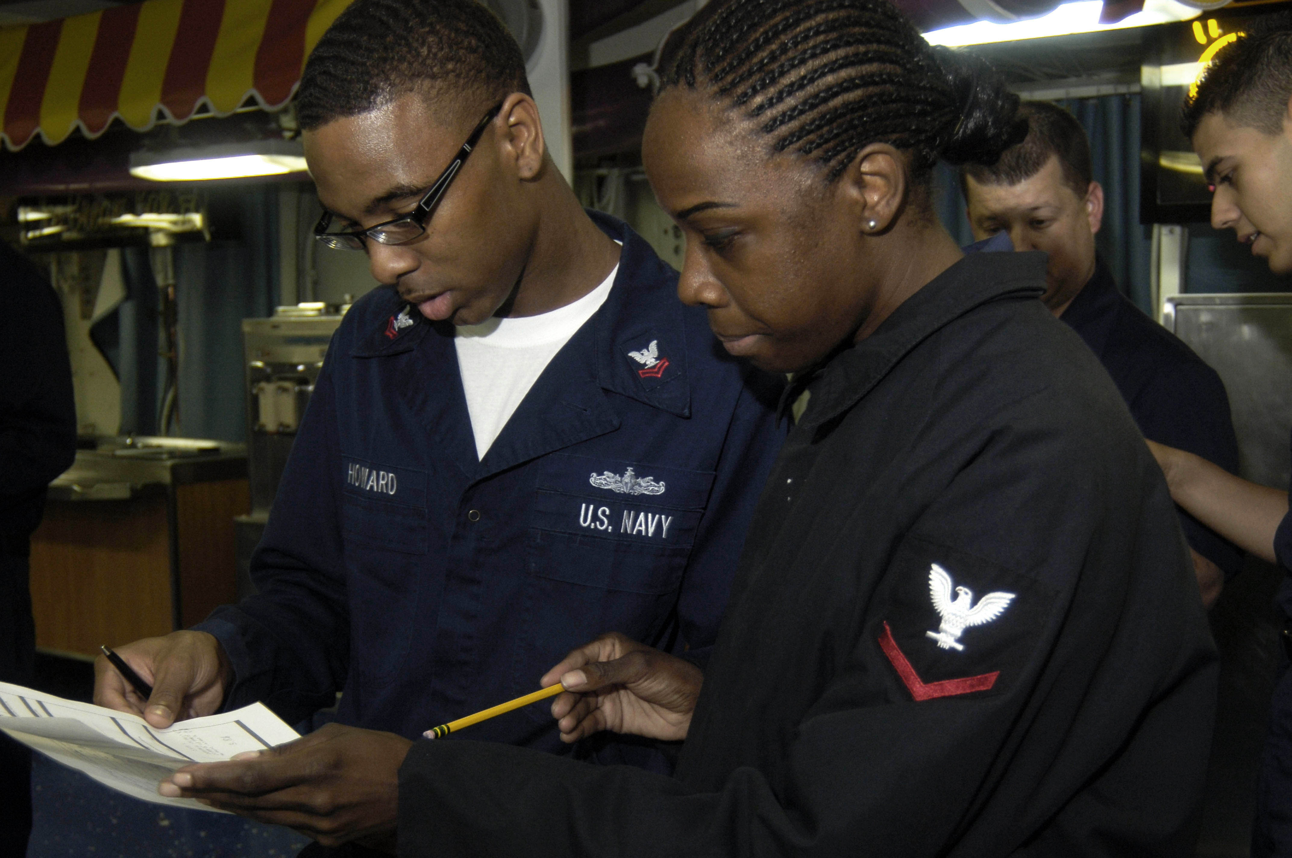 File Us Navy N W 050 Legalman 2nd Class Aundra Howard Looks Over His Advancement Exam