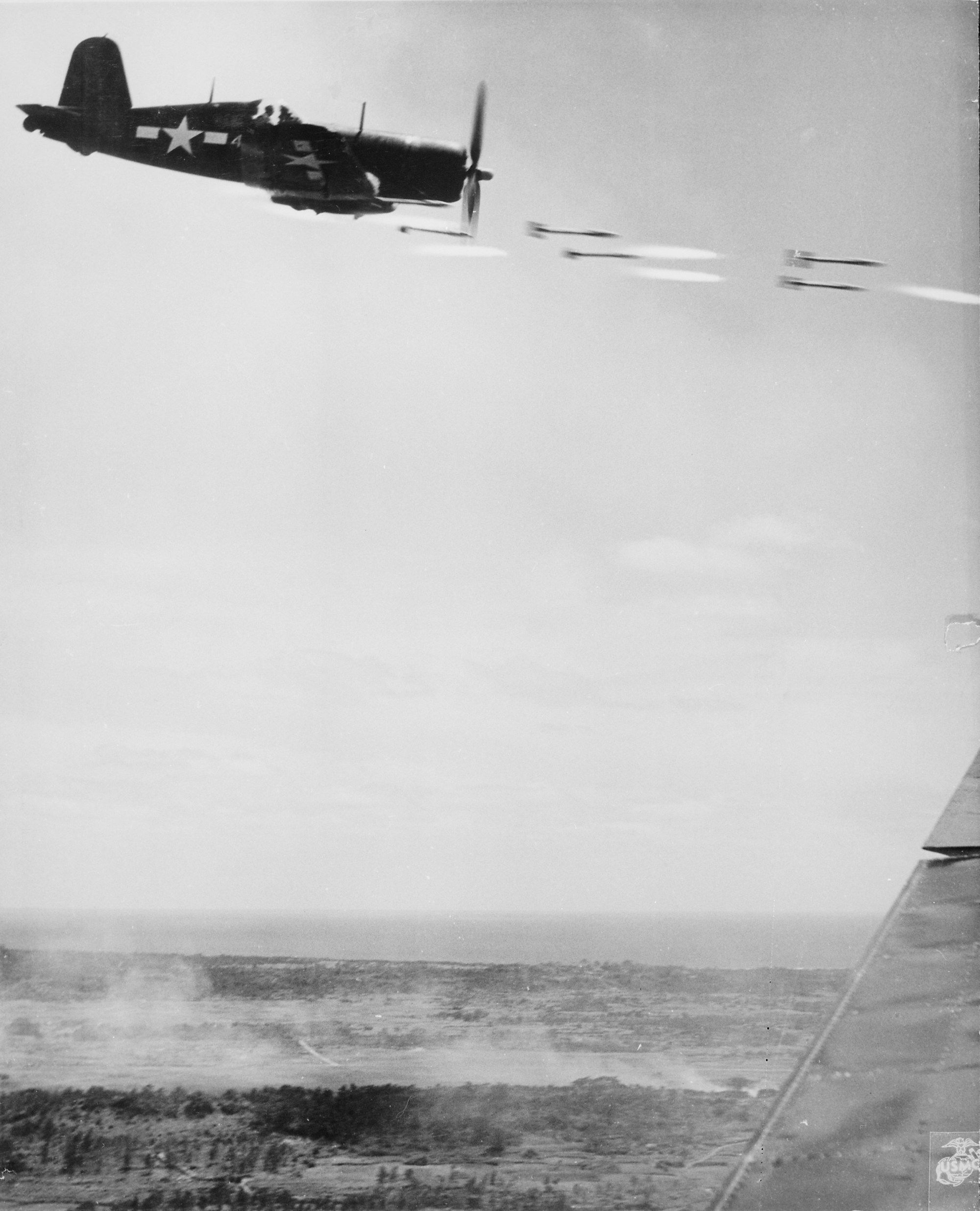 hight resolution of a corsair fires its rockets at a japanese stronghold on okinawa