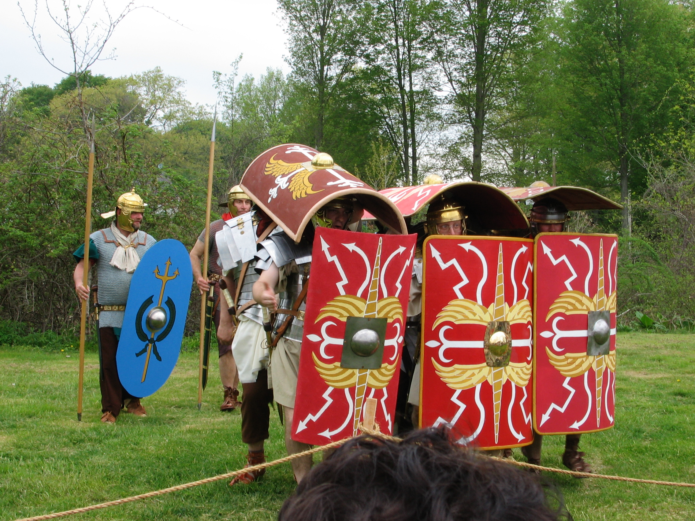 Roman re-enactors demonstrate a testudo formation (The Tortoise).