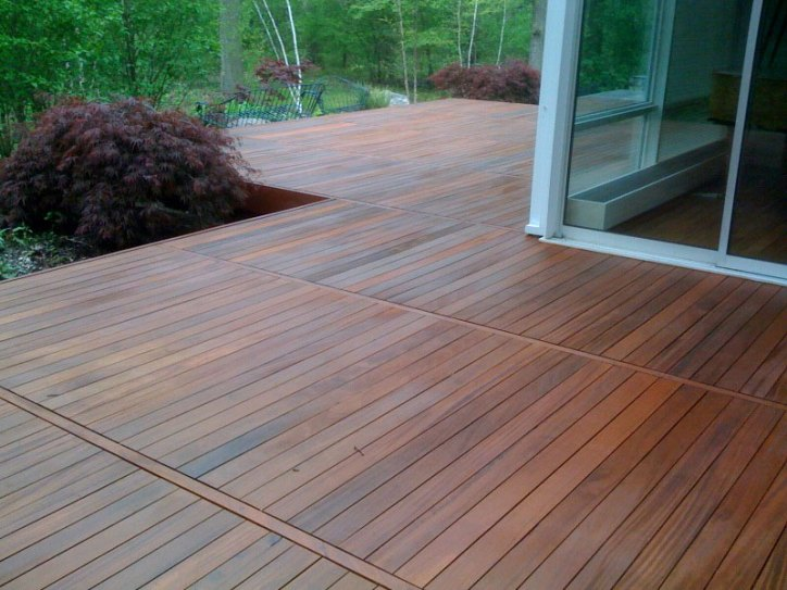 Interior Design on a Budget Outdoor Patio with Dark Wood Deck Stain