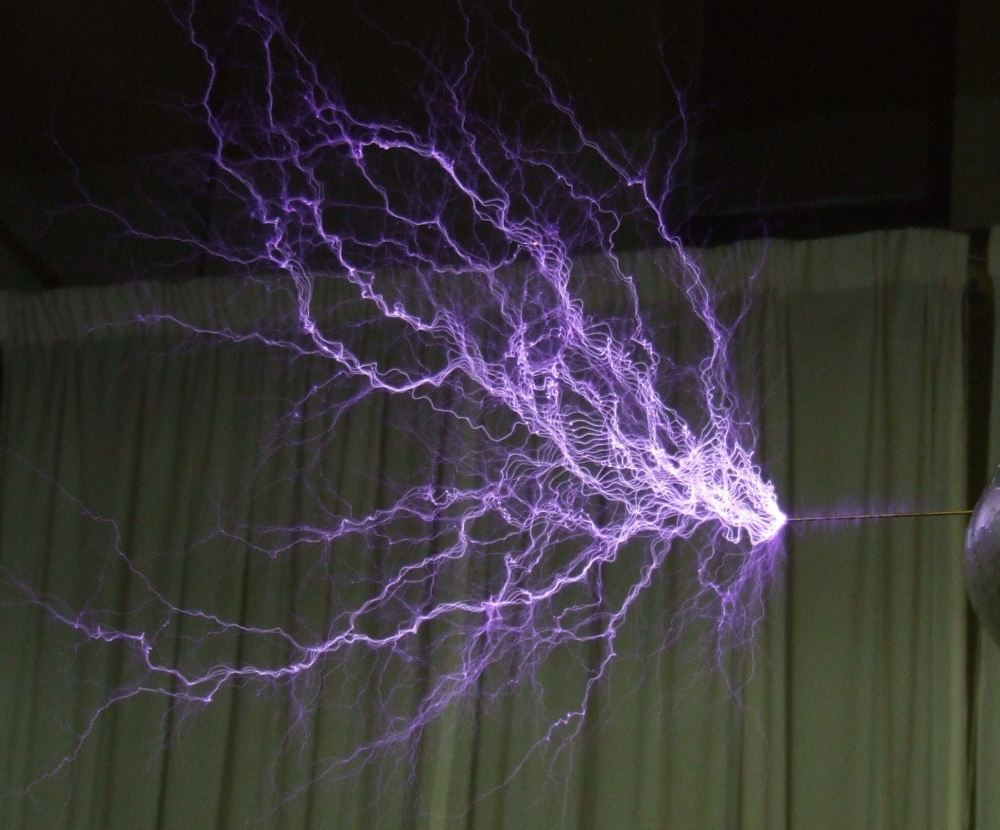 medium resolution of electric discharge showing the lightning like plasma filaments from a tesla coil