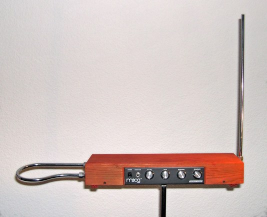 A theremin - a box on a pedestal with an antenna on one side, a metal loop on the other