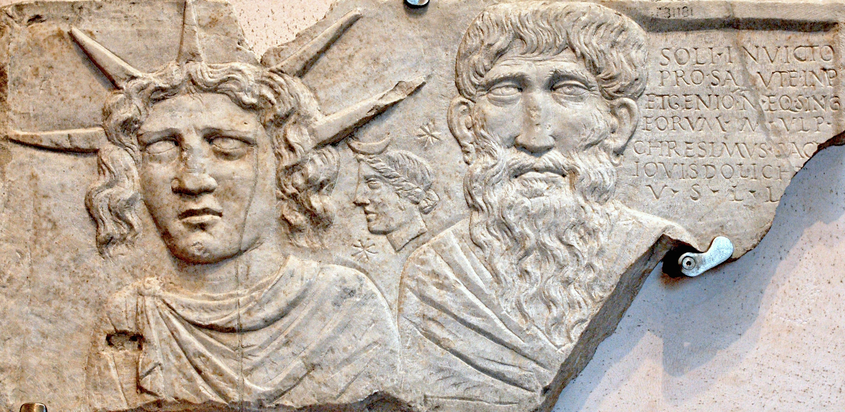 https://i0.wp.com/upload.wikimedia.org/wikipedia/commons/c/ca/Stele_Sol_Invictus_Terme.jpg