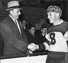 Ace Bailey (left) of the Toronto Maple Leafs s...