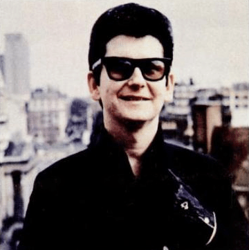 young roy orbison on city rooftop smiling