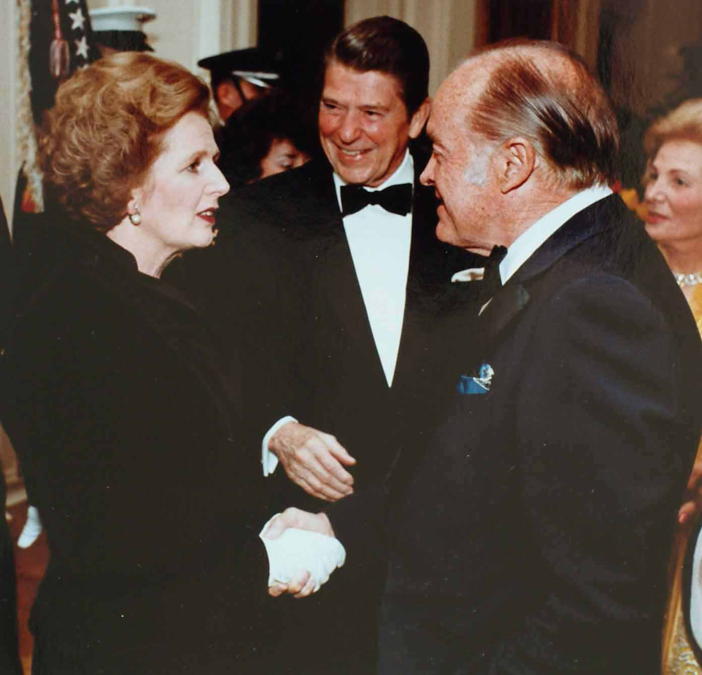 https://i0.wp.com/upload.wikimedia.org/wikipedia/commons/d/d8/Thatcher_with_Reagan_and_Bob_Hope.jpg