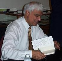 English: Ravi Zacharias signing books at the F...