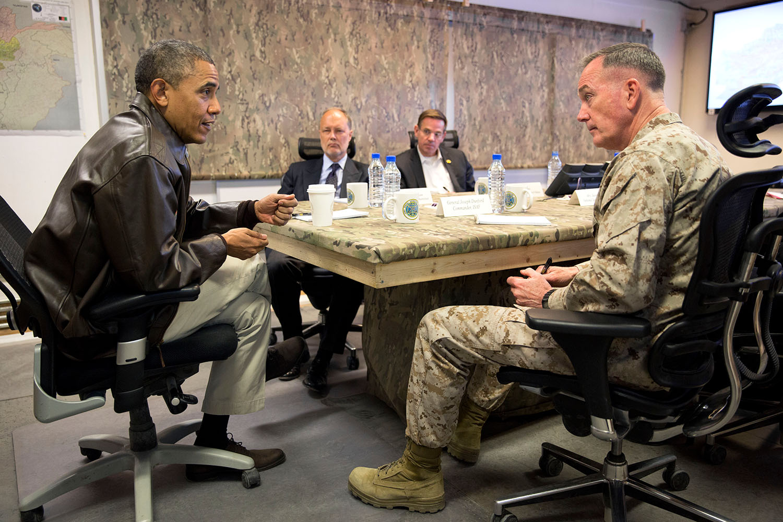 FilePresident Barack Obama receives a briefing from Gen
