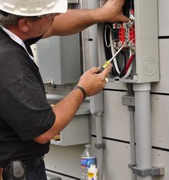 file electrician mike hughes installing meter base jpg [ 2848 x 4288 Pixel ]