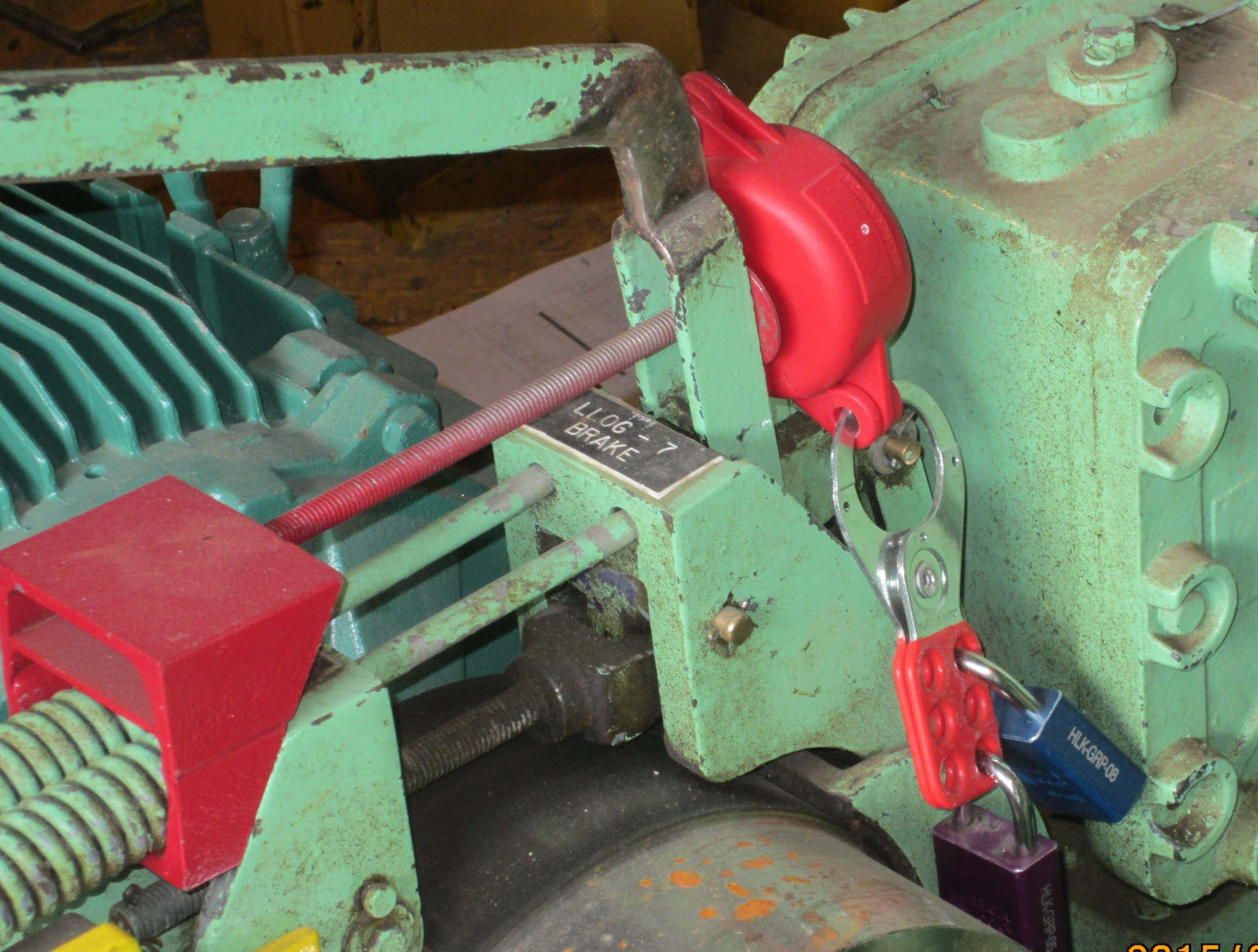 hight resolution of a lockout device applied to a hoist brake this prevents unintended movement of the hoist the lockout hasp is secured with two padlocks