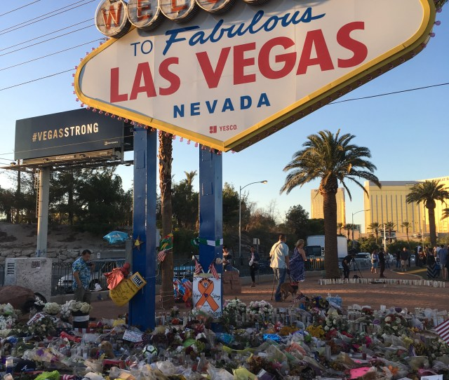 The Welcome To Fabulous Las Vegas Sign Adorned With Flowers On October   A Week After The Shooting