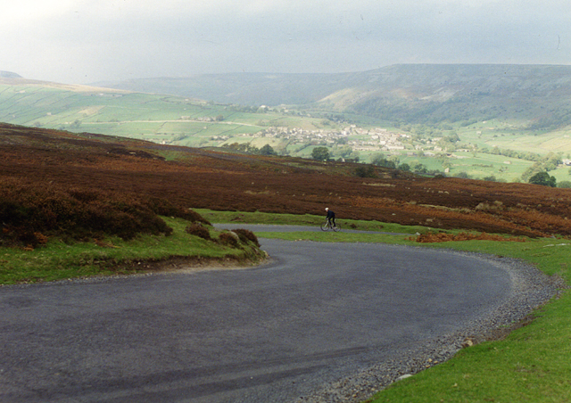 English: Lone cyclist above Reeth