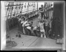 File Crew Men Pulling Rope Mast Board