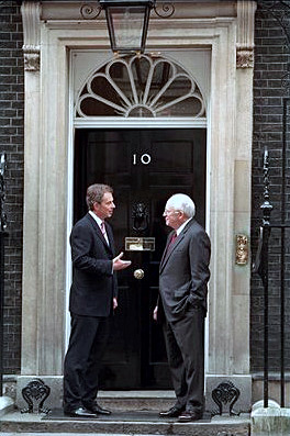 Tony Blair and Dick Cheney at the main door to...