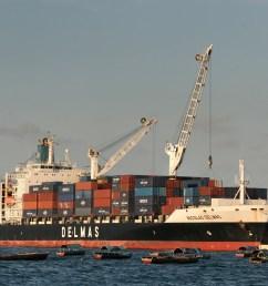 a delmas container ship unloading at the zanzibar port in tanzania [ 4469 x 2592 Pixel ]