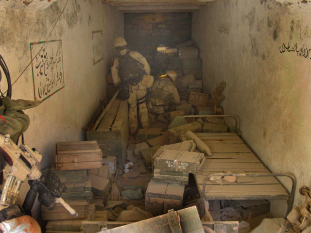 English: US Navy SEALs clearing cave complexes...