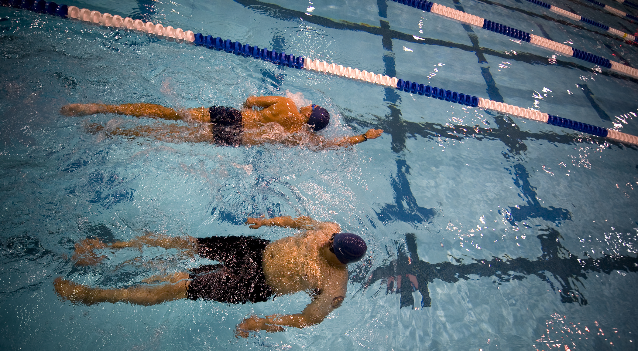wheelchair volleyball dining chair skirt file:us navy 100511-n-6932b-001 competitors swim warm-up laps while practicing for upcoming ...