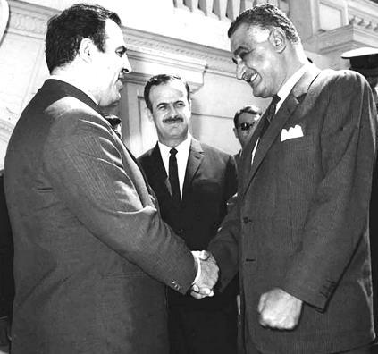 https://i0.wp.com/upload.wikimedia.org/wikipedia/commons/f/ff/Nasser,_Atassi_and_Assad.jpg