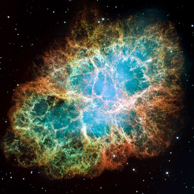Optical mosaic image of the Crab nebula, thanks to the Hubble Space Telescope. The bluish glow from the central region is due to synchrotron radiation.
