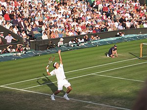 Roger Federer serving in a match against Marat...