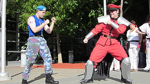 Cosplayers portraying M. Bison and the live-ac...
