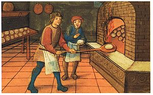 A baker with his assistant. As seen in the ill...