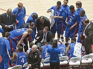 Bill Self and Kansas Jayhawks basketball playe...