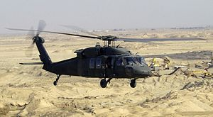 UH-60L Blackhawk helicopter flies a low-level ...