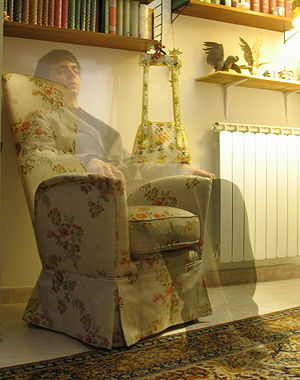 A supposed ghost said to be sitting on a chair.