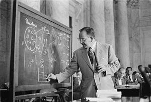 Dr. Mark Mills drawing diagrams on a blackboar...